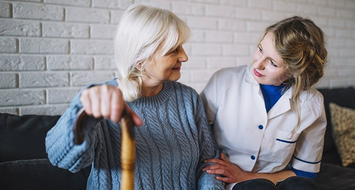 senior care provider with patient